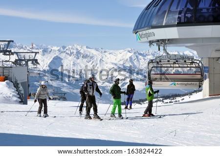 KAPRUN, AUSTRIA - CCA. MARCH: Unidentified skiers enjoying the last ski week of the season in the Austrian Alps in the ski resort of Zell am See. In March, 2012 in Zell am See, Austria