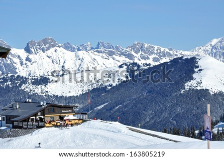 KAPRUN, AUSTRIA -CIRCA MARCH 2012: Unidentified skiers enjoy the last ski week of the season at a mountain lodge in the Zell am See ski resort circa March 2012 in Zell am See, Austrian Alps.