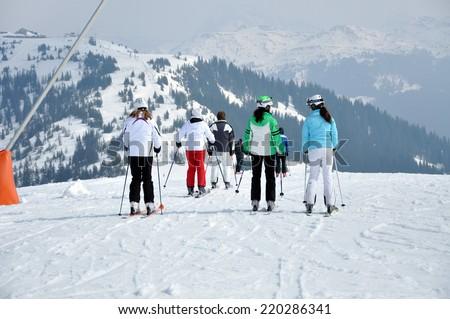 KAPRUN, AUSTRIA - CIRCA MARCH 2012: Unidentified skiers enjoy the last ski week of the season at a mountain lodge in the Zell am See ski resort circa March, 2012 in Zell am See, Austrian Alps