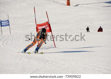 KAPRUN AUSTRIA - MARCH 5: Maiskogel Fanlauf 2011. Unidentified participant of charity ski race with many celebrities in austria on March 5, 2011 at the Maiskogel in Kaprun, Austria