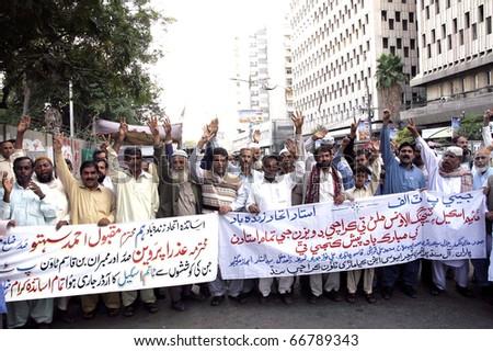 KARACHI, PAKISTAN - DEC 07: Members of All Sindh Primary Teachers Association chant slogans in favor of their demands during a protest demonstration press club on December 07, 2010 in Karachi, Pakistan.
