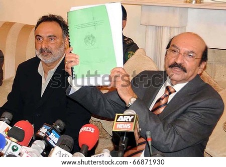 KARACHI, PAKISTAN - DEC 08: Sindh Chief Minister, Syed Qaim Ali Shah, holds judicial commission report on ?Tori Bund Breach? during press conference at CM House on December 08, 2010 in Karachi. - stock photo