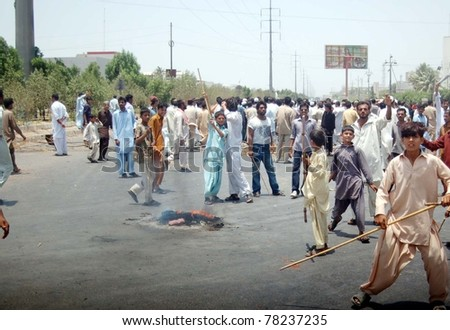 KARACHI, PAKISTAN - MAY 29: Residents of Korangi are protesting against shortage of drinking water and electricity load-shedding in their area during demonstration on May 29, 2011 in Karachi, Pakistan
