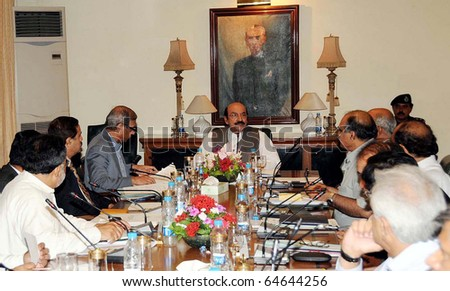 KARACHI, PAKISTAN - NOV 07: Sindh Chief Minister, Syed Qaim Ali Shah, presides over meeting regarding Council of Common Interest held at CM House  on November 07, 2010 in Karachi, Pakistan.