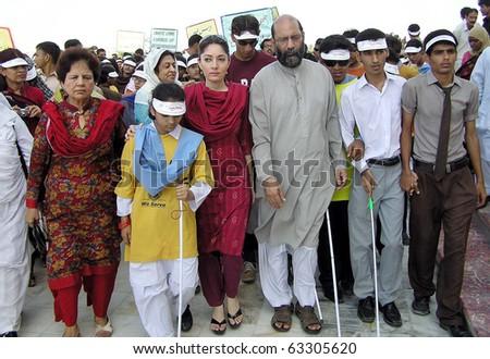 "KARACHI, PAKISTAN - OCT 15: CM Advisor, Sharmila Farooqi, leads walk at Quaid-e-Azam Mausoleum, on occasion of the ""World White Cane Safety Day"" on October 15, 2010 in Karachi."