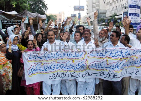 KARACHI, PAKISTAN - OCT 13: Members of All Pakistan Clerks Association (APCA) chant slogans in favor of their demands during a protest demonstration  on October 13, 2010 in Karachi, Pakistan. - stock photo