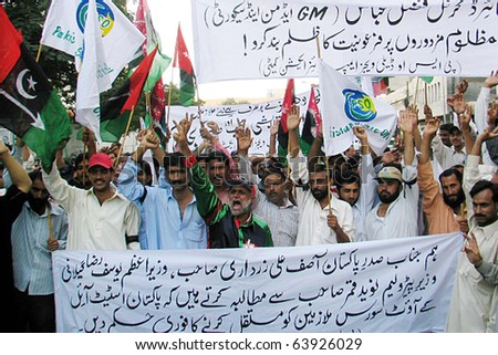 KARACHI, PAKISTAN - OCT 27: State oil company employees shout slogans in favor of their demands during a protest demonstration arranged by PSO Daily Wages Employees on October 27, 2010 in Karachi.