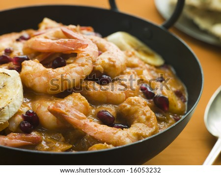 Karahi Dish with Kashmiri Tiger Prawn Curry with serving spoon