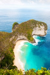 Karang Dawa, Manta Bay or Kelingking Beach on Nusa Penida Island, Bali, Indonesia. Tropical beach with a turquoise ocean among the rocky cliffs. Sunset on a tropical island. Travel concept.