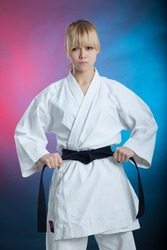 karate girl with black belt posing