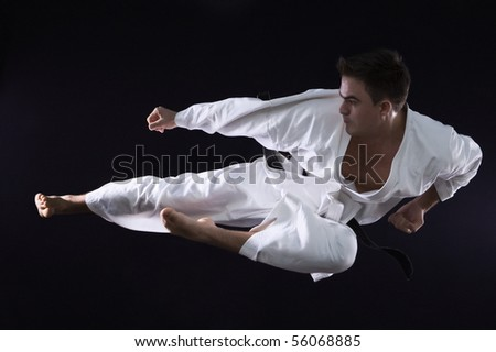 karate man champion of the world on black background studio shot