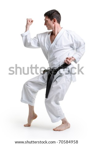 Karate. Man in a kimono with a white background