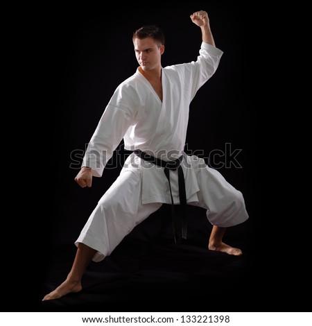 Karate Man With Black Belt Posing Champion Of The World