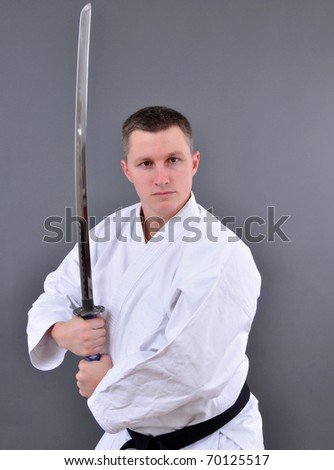 Karate man with single edged Japanese sword