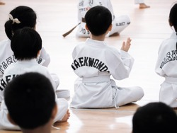 Karate or tae kwon do,martial arts.A closed up shot little kids wearing white kimono with white belt in training course.Extreme fight sports. Concepts of becoming a professional fighter