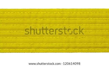 Karate yellow belt closeup isolated on white background