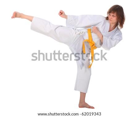karateka girl isolated on white background. studio shot