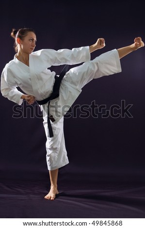 karateka girl on black background studio shot stock photo 49845868