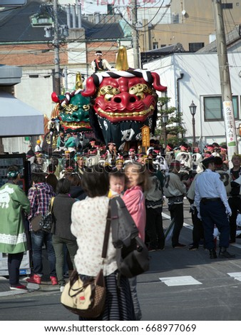 Karatsu city, Saga, JAPAN, November 4 2016: The autumn festival with people pull a float around through the streets in the city. This is Karatsu Kunchi. The festival held from November 2 to 4. #668977069