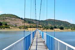 Kardjali ,Bulgaria August 24: Rope bridge for Village Lisicite on coast of  Studen kladenec Dam,Eastern Rhodopes Kardjali ,Bulgaria 2020