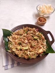 Karedok or keredok is a typical Sundanese, Indonesian food. made with raw vegetable ingredients, namely cucumber, bean sprouts, cabbage, long beans, basil and eggplant then given peanut sauce.