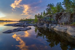 Karelia. Nature Russia. Ladoga lake. Ladoga during sunset. Northern nature. Landscape of Russian lake. Nature of Karelia. Traveling to regions of Russia. Karelia on a background of blue sky.