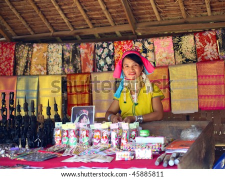 KAREN VILLAGE, THAILAND - AUG 21:A woman from The Padaung-Karen long-necked tribe sells goods at the local market on August 21, 2007 in Karen Village, Thailand
