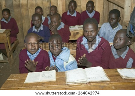 Karimba School with school children at their desk in classroom in North Kenya, Africa