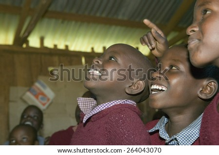 Karimba School with school children smiling in classroom in North Kenya, Africa
