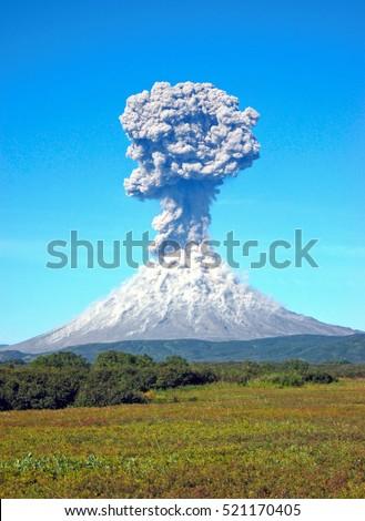 Stock Photo Karimskiy volcano. Volcanic eruption in Kamchatka, ash flow and destroyed