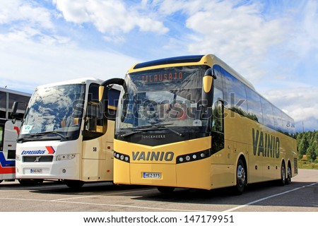 KARJAA, FINLAND - JULY 20: Jonckheere and Volvo coach parked in Karjaa, Finland on July 20. Since 2013, bus and coach passengers enjoy greater rights on journeys over 250 km within EU.