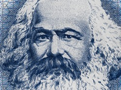 Karl Marx portrait on East German 100 mark (1975) banknote closeup macro, famous philosopher, economist, political theorist, sociologist and revolutionary socialist.