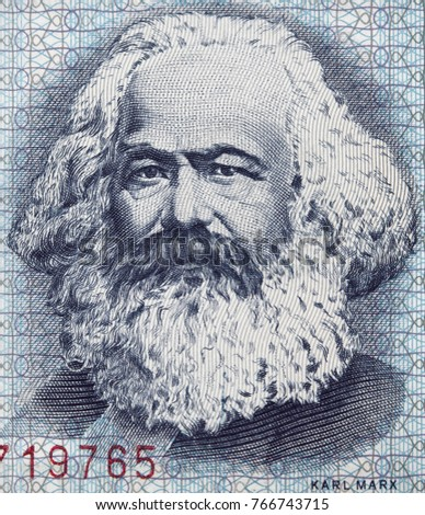 Shutterstock Karl Marx portrait on East German 100 mark (1975) banknote closeup macro, famous philosopher, economist, political theorist, sociologist and revolutionary socialist.