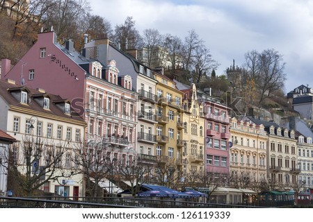 KARLOVY VARY, CZECH REPUBLIC - NOVEMBER 12: Cityscape with facades of hotels with spa and residential buildings with shops and restaurants on November 12, 2012 in Karlovy Vary, Czech Republic.