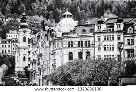 Karlovy Vary town with Church of Saint Mary Magdalene, Czech republic. Autumn scene. Travel destination. Black and white photo.