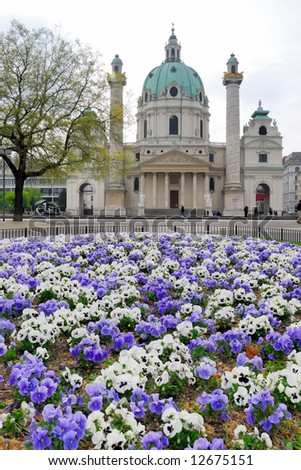 Karlsplatz and Karlskirche with flower bed - stock photo
