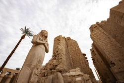 Karnak Temple Complex in Luxor. A famous ancient Egyptian temple ruin with colossal statue of Ramses II.
