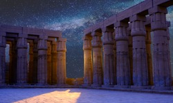 Karnak Temple, The ruins of the temple, Embossed hieroglyphs on the wall. The night sky.