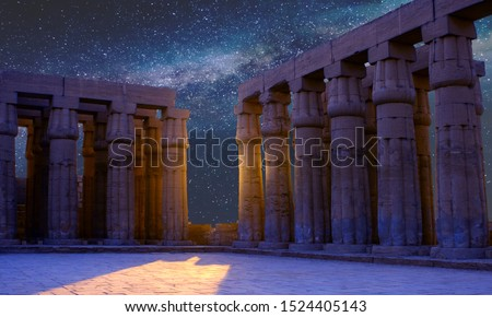 Karnak Temple, The ruins of the temple, Embossed hieroglyphs on the wall. The night sky. #1524405143