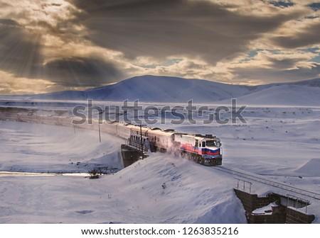 Kars, Turkey - January, 2018: Ankara-Kars (Diesel Train) Eastern Express train in the winter with sunrise. The travel of Eastern Express (Dogu Ekspresi) takes 24 hours between Ankara and Kars.