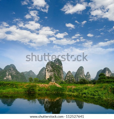 karst mountain landscape and reflection in yangshuo, guilin, China - stock photo