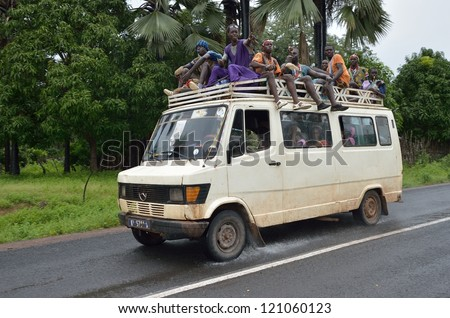 KARTIAK,SENEGAL-SEPT 18:people in the bus roof go to ritual of Boukoutt of Initiation ceremony on Sept 18,2012 in Kartiak,Senegal.The ceremony occurs every 30 years and celebrates boys becoming men