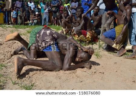 KARTIAK,SENEGAL -  SEPTEMBER 27:Men in the traditional struggle of Senegal this sport is the most ancient competitive discipline in Kartiak, Senegal on September 27,2012.