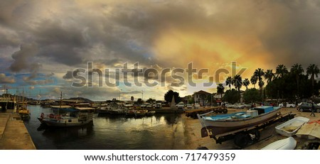 Kas harbor on a rainy sunset  #717479359