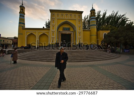 KASHGAR, CHINA - OCT 2 :  A Uyghur man walks in front of Id Kah Mosque on the last day of Ramadan October 2, 2008 in Kashgar, Xinjiang province western China.