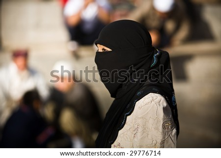 KASHGAR, CHINA - OCT 2 : Young Uyghur woman wears traditional head veil during Ramadan celebrations on the street October 2, 2008 in Kashgar, Xinjiang province western China.