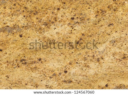 Kashmir Gold Granite (India) / Surface of the granite with yellow, gold and brown tint for background
