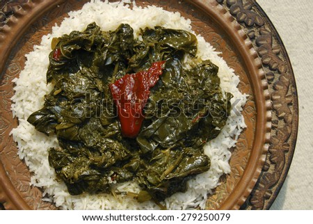 Kashmir green dish which is made by spinach cooked with mustard oil and Indian spices and served with rice  #279250079