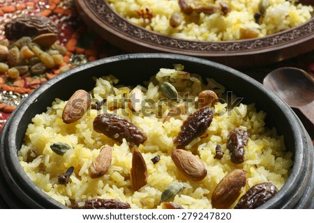 Kashmiri modur pulao made of rice cooked with sugar, water flavored with Saffron and dry fruits