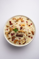 Kashmiri pulao made of Basmati rice cooked with spices and flavored with Saffron and dry fruits